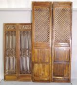 Two pairs of 20th century Chinese hardwood screens, the largest 56cm wide x 230cm high,