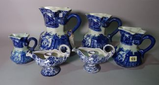 A graduated set of modern Masons style blue and white jugs, the tallest 25cm,