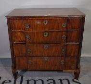 A 19th century French breakfront mahogany chest of four long graduated drawers on fluted tapering