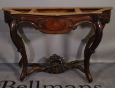 A 19th century continental walnut and kingwood serpentine console table base on four scroll