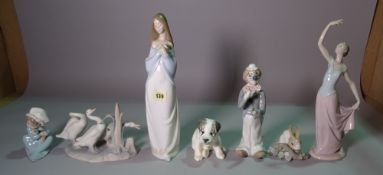 A group of ceramic figures including, Nao, Lladro and sundry, the tallest 35cm (7).