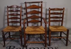 A matched set of nine oak Lancashire ladder back dining chairs to include one carver, (9).
