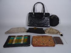 A quantity of early 20th century vintage purses and bags, (qty).