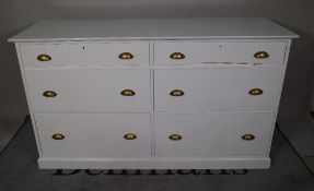 A 20th century grey painted chest of six graduated drawers on plinth base, 150cm wide x 87cm high.