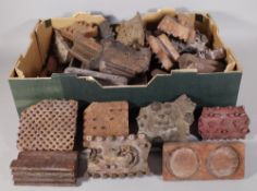 A large group of late 19th century early 20th century fabric wooden painting blocks in a variety of