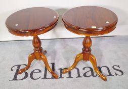 A pair of 20th century mahogany circular side tables, 48cm diameter x 64cm high, (2).