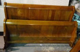 A 20th century hardwood double sleigh bed, 168cm wide x 98cm high.