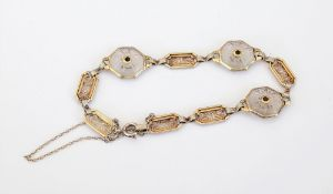A two colour gold and diamond bracelet,