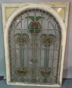 An early 20th century Art Nouveau style stained glass window, depicting a Glasgow Rose,