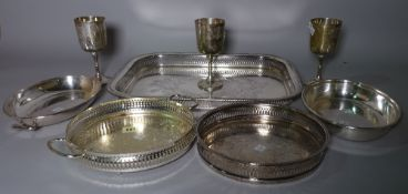 Silver plated wares, comprising; five twin handled serving trays, entree dishes, goblets and sundry,