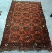 A Beshir rug, the madder field with six rows of three flowerhead guls and flowerhead border,
