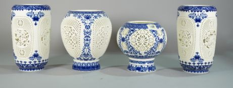 Asian ceramics, comprising; modern blue and white vases with pierced floral pattern decoration,