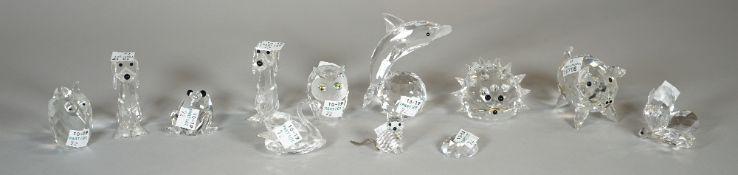 Eleven small Swarovski crystal models of animals, (11).