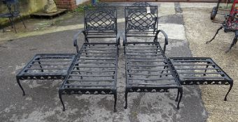 Forecast Furniture LTD; a pair of black painted metal sun loungers,