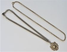 A gold circular link neckchain, detailed 9 C, on a gilt metal boltring clasp,