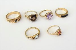 A 9ct gold, sapphire and diamond set three stone ring, having ropetwist decoration, a 9ct gold ring,