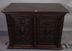An 18th century style carved oak side cupboard, 95cm wide x 69cm high.