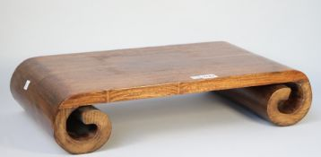 A 20th century Chinese hardwood hongmu stand with scroll ends, 55cm wide,