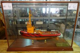 A large 20th century scratch built model of an Irish fishing boat Lyrie, in a glass case,