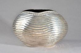 A European bowl, probably Turkish, of oval form with wavy fluted decoration within a decorated rim,