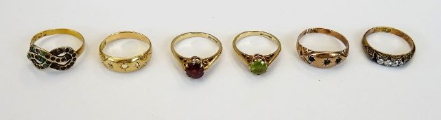 A 9ct gold ring, claw set with a circular cut peridot, a 9ct gold ring,