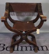 An 18th century style continental 'X' frame folding open armchair, 71cm wide x 87cm high.