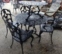 A set of four 20th century black metal garden chairs to include two carvers,