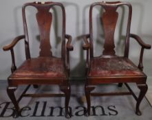 A set of ten Queen Anne style mahogany vase back dining chairs to include two carvers, (10).