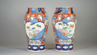 A pair of late 19th century Japanese Seto ware vases, with character marks to bases, 32cm high, (2).