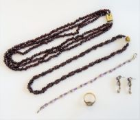 An oval Florentine micro-mosaic ring, in a floral design, ring size K, two garnet bead necklaces,