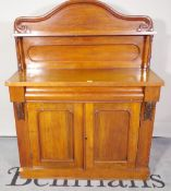 A Victorian mahogany chiffonier with single drawer over panelled cupboard doors,