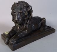 Ronald Moll limited edition bronzed figure of recumbent lion on rectangular base,