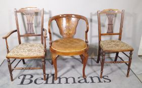 A set of four Edwardian mahogany inlaid dining chairs and a tub chair, (5).