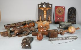 Tribal interest, a quantity of mostly 20th century hardwood figures, a club, two masks and sundry,