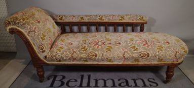 A Victorian walnut framed upholstered chaise longue, on turned supports, 190cm long x 77cm high.