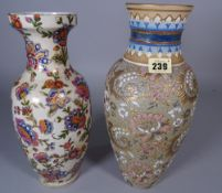 A Royal Doulton stoneware vase decorated with flowers and another floral vase, 36cm high.