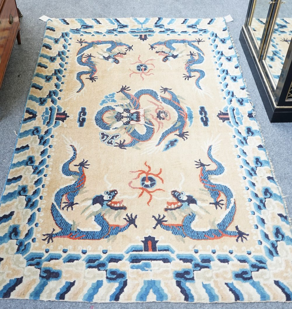 Lot 1533 - An early 20th century Chinese dragon rug,