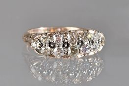 A gold and diamond set ring, in an oval half hoop cluster design,
