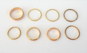 A 9ct gold plain wedding ring, London 1930, a 9ct gold plain wedding ring,