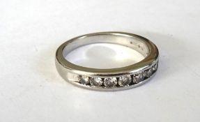 A platinum and diamond half hoop eternity ring,