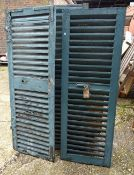 A group of three early 20th century French blue painted window shutters, 51cm wide x 148cm high,