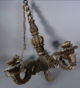 An Italian carved wooden five branch chandelier, 19th century, distressed grey with gilt traces,
