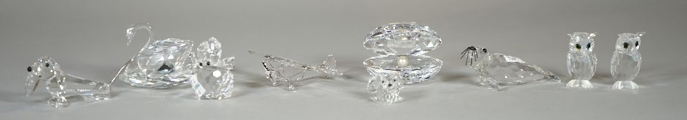 Swarovski; a group of nine figures comprising, a seal, a swan, a dachshund, an oyster, a plane,