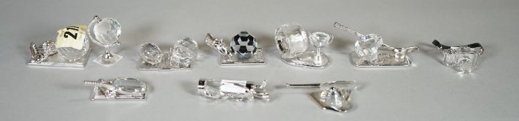 Swarovski, a group of ten crystal figures of sports related models, (10), (boxed).