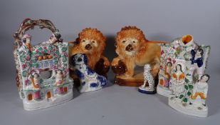 Ceramics including; a group of four Staffordshire flatback figures, a pair of lions and two dogs,