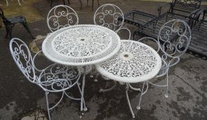 A set of five 20th century white painted wire work open armchairs, a similar circular garden table,