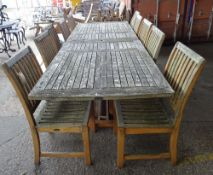 Westminster Teak; a 20th century extending garden table,