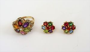 A pair of 18ct gold and varicoloured gemstone set seven stone cluster earstuds, including garnet,