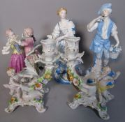 Ceramics, comprising; a pair of 20th century German candle holders, 17cm high,