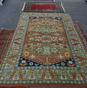 A machine made Caucasion design rug, 240cm x 172cm and an Indian Bokhara rug, 153cm x 90cm, (2).